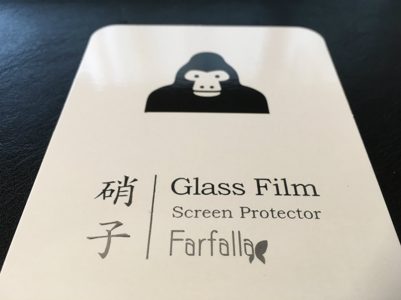 1249-201605_Farfalla Glass Film Gorilla iPhone SE 01